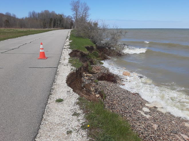 A portion of South Lake Michigan Drive in the town of Clay Banks, approximately one-half mile northeast of the intersection with Door County U, saw some damage after high winds and waves..