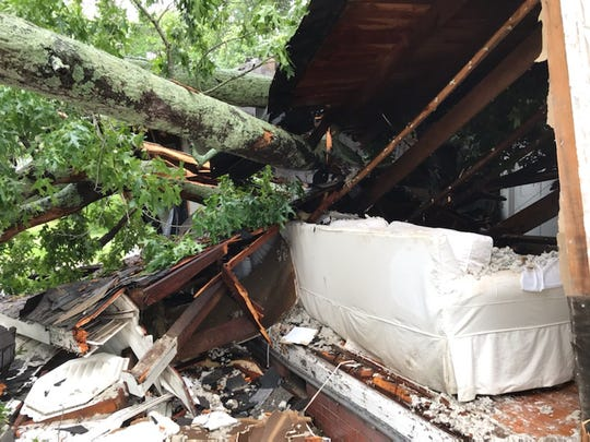 A downed tree decimated Troy and Marissa Kinnunen's Greer home Wednesday morning as floodwaters rose in Greenville County.
