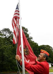 Jeremiah Palmer of Anderson, Marine Corps Lima 3/7 Vietnam Veteran and current Chaplain with the Marine Corps League Upstate Detachment 1108, with his U.S. and Marine flags on a pole in his front yard.