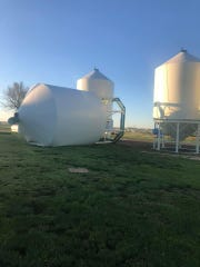 A silo falls after a wind storm in McCone County.