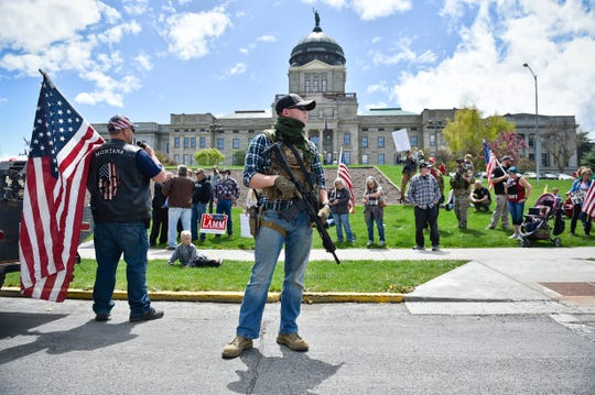 Protesters gather outside the Montana State Capitol in Helena, Mont., Wednesday, May 20, 2020 criticizing Gov. Steve Bullock's response to the COVID-19 pandemic. (Thom Bridge/Independent Record via AP)