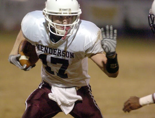 Henderson County's Chris LaMar anticipates the hit from an Owensboro player after catching a pass during their 2005 game in Owensboro.