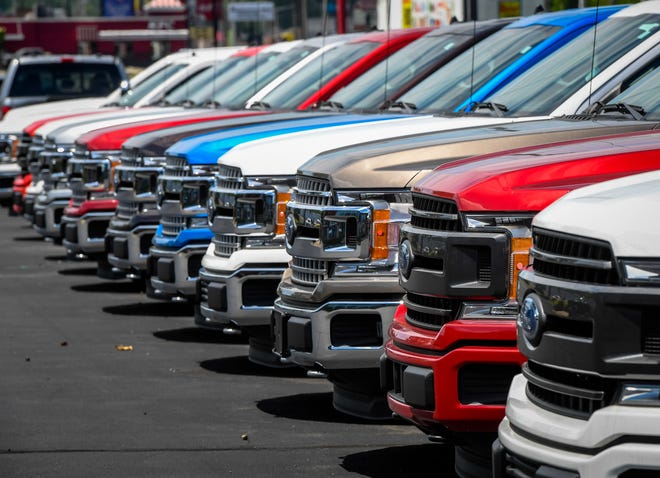 Trucks on the lot at Henderson Ford, car dealerships, like all businesses, are having to adapt to new ways of doing things in this era of COVID-19 Thursday, May 21, 2020.