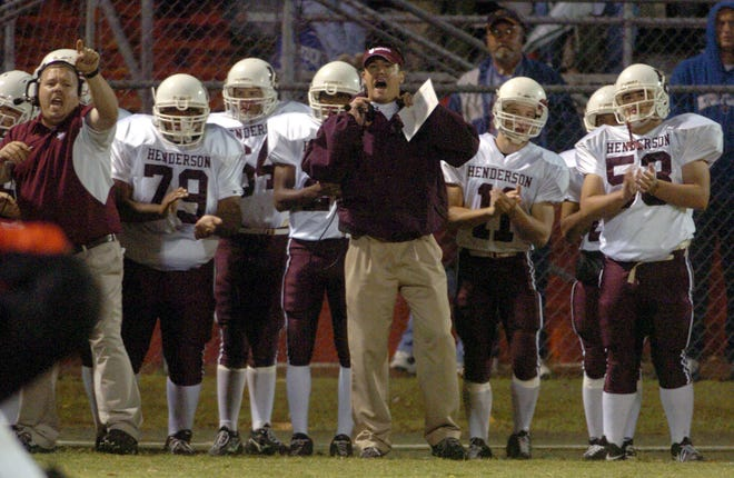 Henderson County coach Duffer Duffy, center, barks out orders to his players on the field during the 2005 game at Rash Stadium in Owensboro.