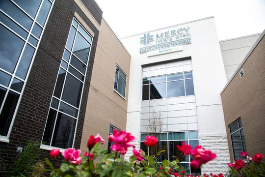 Flowers bloom outside the front entrance to the Mercy Iowa City Rehabilitation Hospital, Wednesday, May 20, 2020, at 2801 Heartland Drive in Coralville, Iowa.