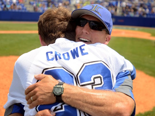 Jackson Christian baseball coach Chuck Cooper hugs Hayden Crowe after winning the Class A state baseball championship at MTSU, Friday, May 23, 2014 in Murfreesboro. The Eagles defeated Grace Christian Academy, 8-2.