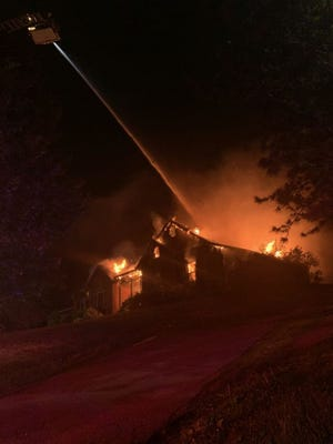 An elderly woman was serious injured when she attempted to rescue the family dog from a large house fire on Suburban Road in West Knox County on Wednesday, May 20 2020.