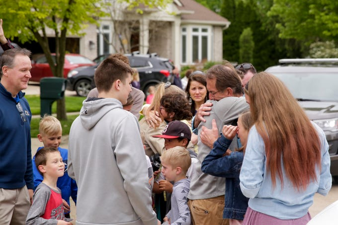 Rob Kochon embraces his family members after recovering from COVID-19 and returning home after months away, Thursday, May 21, 2020 in West Lafayette. Kochon spent 50 days in a Florida hospital, 26 on a ventilator, after contracting COVID-19.