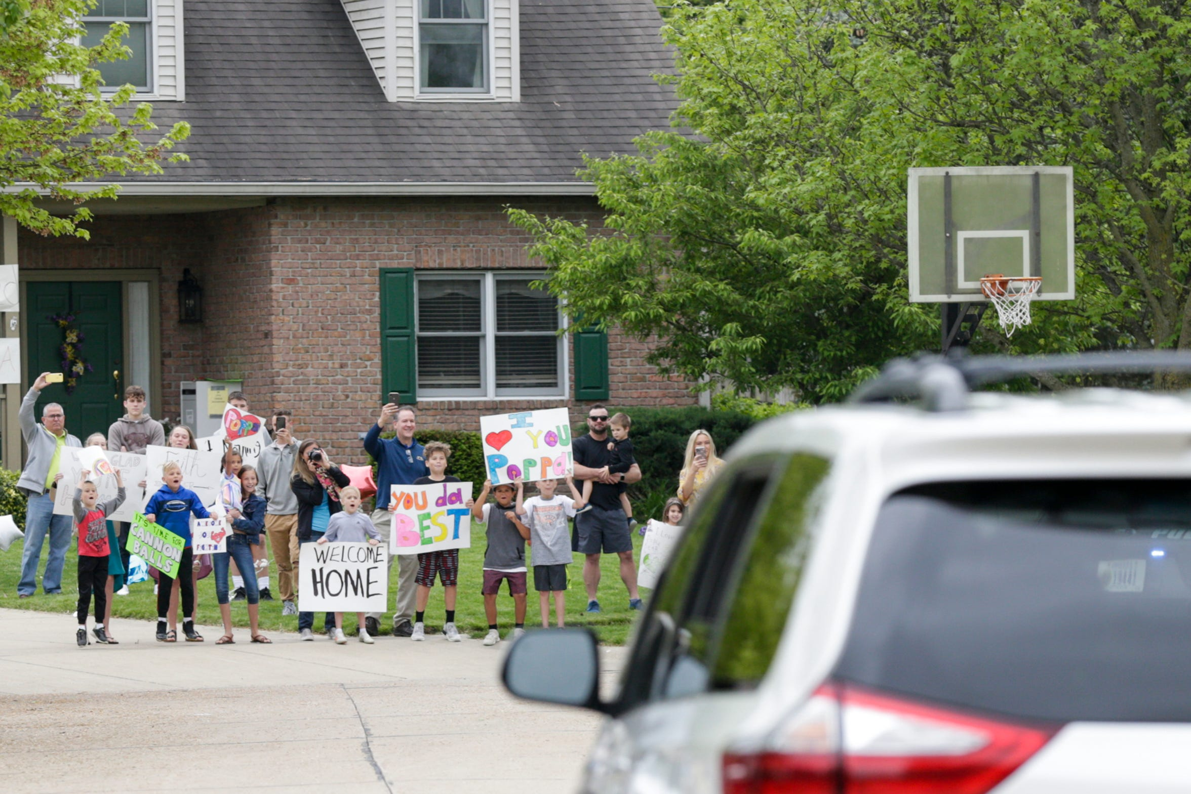 Family members wait outside Rob and Carol Kochon's home as they are welcomed back after months away, Thursday, May 21, 2020 in West Lafayette. Rob Kochon spent 50 days in a Florida hospital, 26 on a ventilator, after contracting COVID-19.