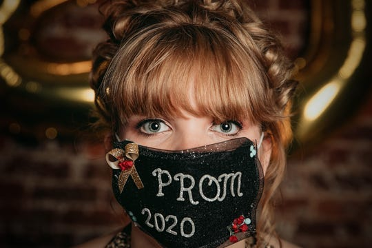 Katelyn Brown from the Class of 2020, poses for a photo in her prom dress.