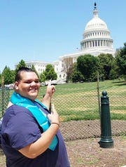 """Dosha """"DJay"""" Joi met U.S. Rep Gwen Moore at Foster Youth Day at the U.S. Capitol in 2019."""