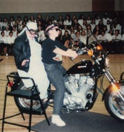 Sister Monica Fumo, then principal at St. Joan Antida High School in Milwaukee, rides into the school's gymnasium on the back of a Harley-Davidson motorcycle in the early 1990s.