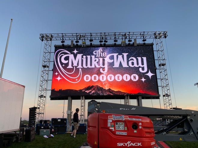 A crew tests out the new 40-foot LED screen at the Milky Way Drive-in Wednesday night. The Franklin outdoor theater is scheduled to open Friday.