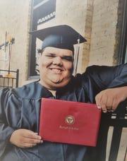"Dosha ""DJay"" Joi at his graduation from Springfield College."