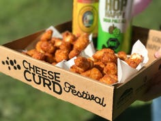 """Cheese Curd Festival in Ellsworth usually has two """"cheese curd centrals"""" that sell three flavors of deep-fried cheese curds: signature beer batter, cinnamon sugar, and one that changes yearly."""