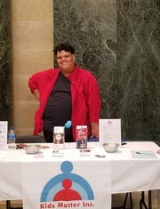 """Dosha """"DJay"""" Joi volunteers at the Hands Around the Capitol lobbying event."""