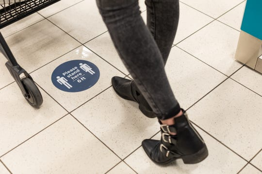 Signage and floor decals have been placed throughout Kohl's stores to encourage 6 feet of social distancing.