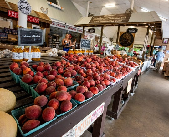 Peaches and other local produce being sold at Peach Park in Clanton, Ala., on Wednesday May 20, 2020.