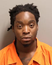 Malcolm Jamal Daniels was charged with shooting into an occupied vehicle.