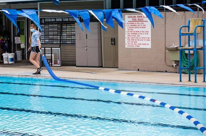 Employees at the Catalina Club prepare the swimming pool and recreation areas for a health inspection Thursday, May 21, 2020.