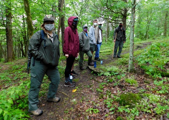 Rangers and hikers at Edgar Evins State Park are wearing masks on their outing.