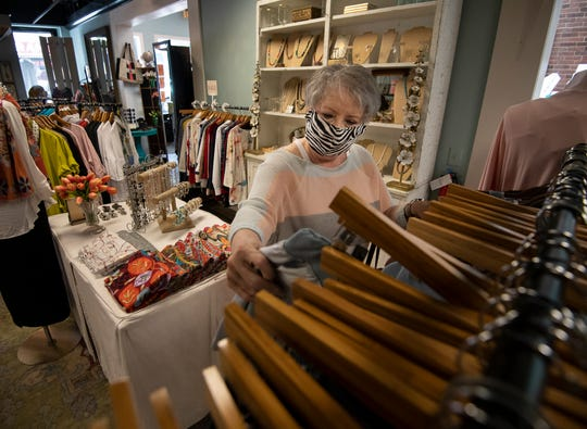 Kathy Bishop shops at Avec Moi Thursday, May 21, 2020 in Franklin, Tenn. Bob Roethemeyer owner of Avec Moi requires his customers and employees to wear masks in his store in Franklin, Tenn. as the phased reopening of businesses in the state continues during the COVID-19 pandemic.