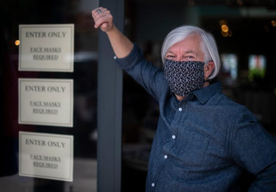 Bob Roethemeyer owner of Avec Moi requires his customers and employees to wear masks in his store in Franklin, Tenn. as the phased reopening of businesses in the state continues during the COVID-19 pandemic. 