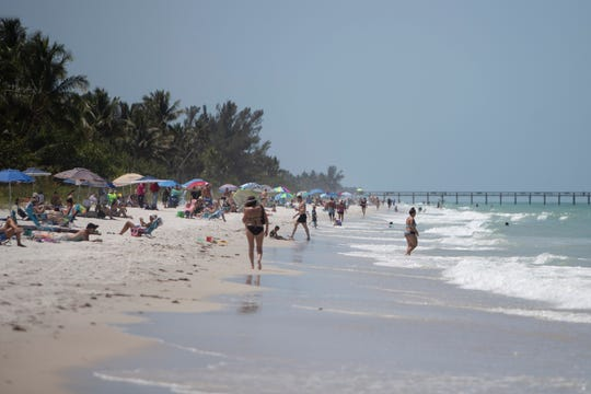 Naples residents enjoy the sunny and warm weather along the beaches of Naples on Thursday, May 21, 2020.