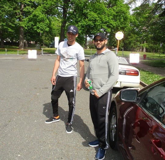 Joseph Goal, at right, and a friend near a closed entrance of Paterson's Eastside Park.