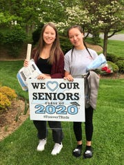 Twins Sophia and Ashley Zaita received their graduation gowns and signs during visits by Mahwah High School faculty and staff to their 234 seniors on Tuesday.