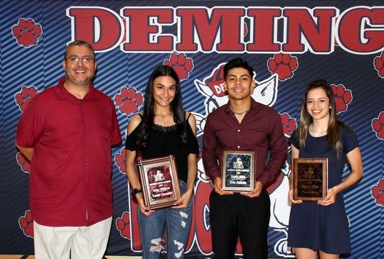 Deming Public Schools Athletic/Activities Director Bernie Chavez (left) presented sports awards on Wednesday to, from left, Yasmin Chaparro, Miss Wildcat Award; Jose Jimenez, Top Scholar Athlete; and Pillar Garcia, Heart of a Wildcat.