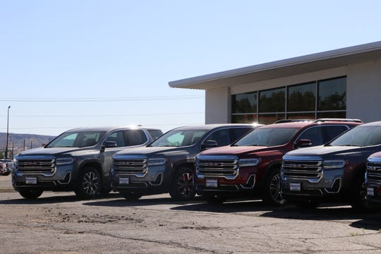 GMC sport utility vehicles sit out front on Thursday, May 21, 2020, at Hi Country Buick GMC in Farmington. Car dealerships across San Juan County look to expand car sales and services as New Mexico gradually reopens in the aftermath of the COVID-19 pandemic.