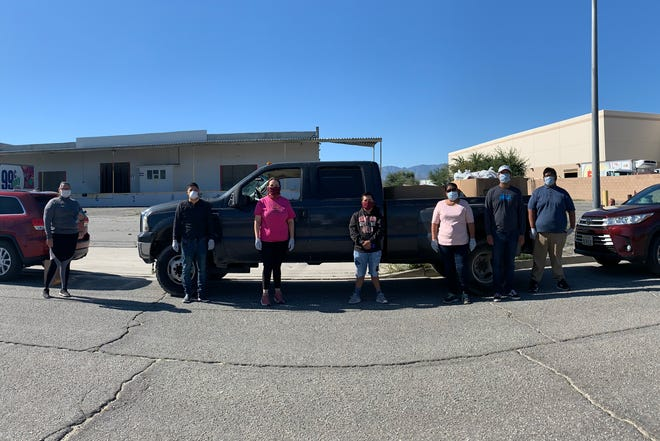 Volunteers with Coachella Valley Parents pose while distributing food to homes in the rural Eastern Coachella Valley.