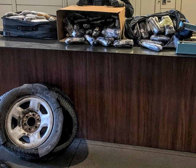 Casa Grande police officers found drugs throughout the vehicle, including a drug-packed spare tire.