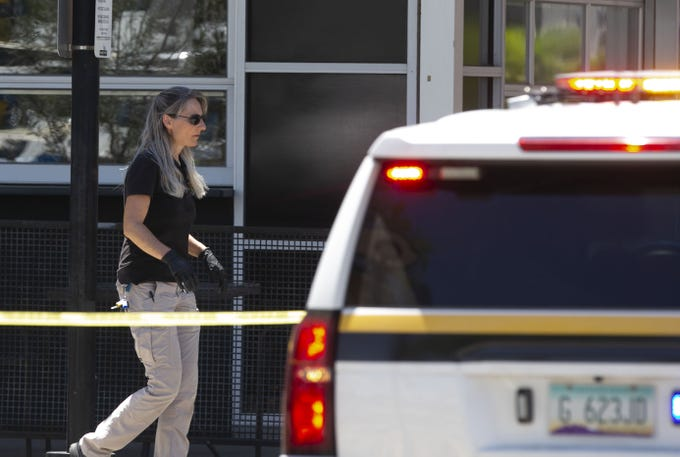 A Glendale police forensics investigator works the scene at the Westgate Entertainment District in Glendale on May 21, 2020. On Wednesday evening, May 20, 2020, there was an active shooter situation where three people were injured, one critically.