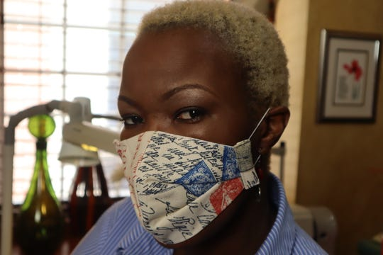 Victoria Kageni-Woodard sporting one of her fashionable face masks.
