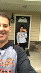 JoJo Gurian poses for her selfie with Palmyra Area High School Principal Scott Richardson. Richardson decided to visit all the seniors in his school after the novel coronavirus canceled classes for the rest of the year.