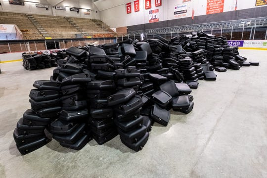 Chairs donated from the former Palace of Auburn Hills are stacked on the floor inside McMorran Arena Thursday, May 21, 2020. The seats are being installed to replace the old wooden ones.