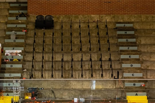 New seats are being installed in McMorran Arena to replace the old wooden ones. The seats were donated from the former Palace of Auburn Hills.