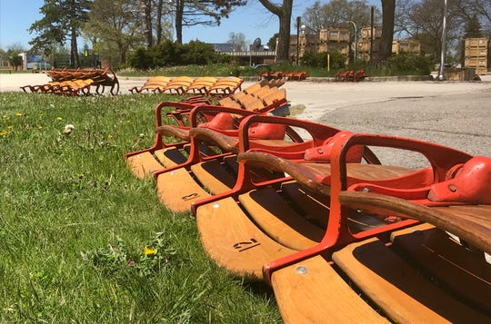Blocks of wooden seats await pick-up on Thursday, May 21, 2020, outside of McMorran Arena in Port Huron. The city is replacing the building's original seats with donated seats from the Palace of Auburn Hills and are making the old McMorran seats available for purchase.