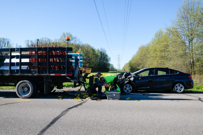 Crews respond to a crash on St. Clair Highway that sent five people to the hospital with non-life threatening injuries Thursday, May 21, 2020, in East China Township.
