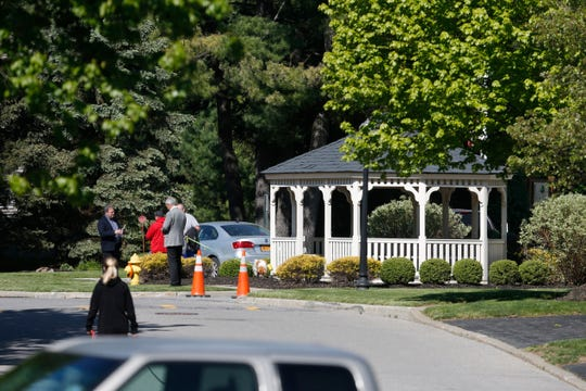 Fishkill Police officers investigate a crime scene on Crestwood Court in Fishkill on May 21, 2020. On the night of May 20 a woman was stabbed at  220 Crestwood Court.
