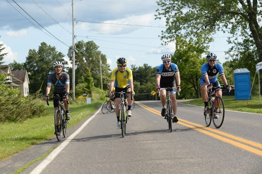 Cyclists ride along the route through New Paltz during the 2019 Ride for Mental Health. From left: Alfred Ling, Mac Dorris, Paul Sternglass and Derek Mansfield.