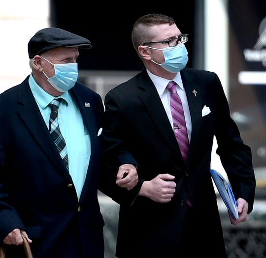 """Rocco Naples of Westmoreland County, right, arrives at the York County Judicial Center for a video-arraignment Thursday, May 21, 2020. He was accompanied by his uncle who was not identified. Naples is accused of threatening to """"have a bullet"""" for Gov. Wolf.  Bill Kalina photo"""