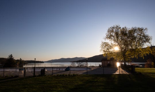 The sun rises over Lake George on Thursday, May 14, 2020.