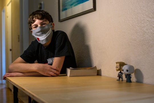 Will Schumacher sits at the desk his father, Jeff, built him at their home in Salem on May 21, 2020.