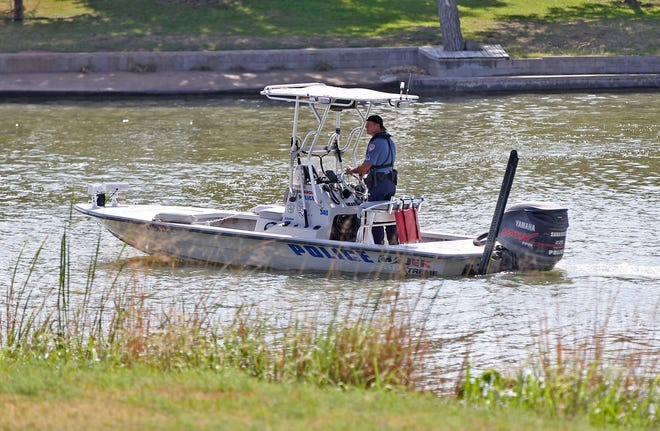 A San Angelo Police Department officer works the scene of a boating accident on Lake Nasworthy on Thursday, May 21, 2020.