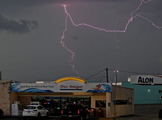 Lightning strikes as a storm rolls in over San Angelo late Wednesday, May 20, 2020.