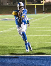 Angelo State University's Kyle Washington strolls into the end zone for a touchdown against Texas A&M-Commerce on Oct. 11, 2014.