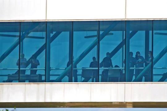 Health care professionals at Shannon Medical Center wait to watch a military flyover Thursday, May 21, 2020.